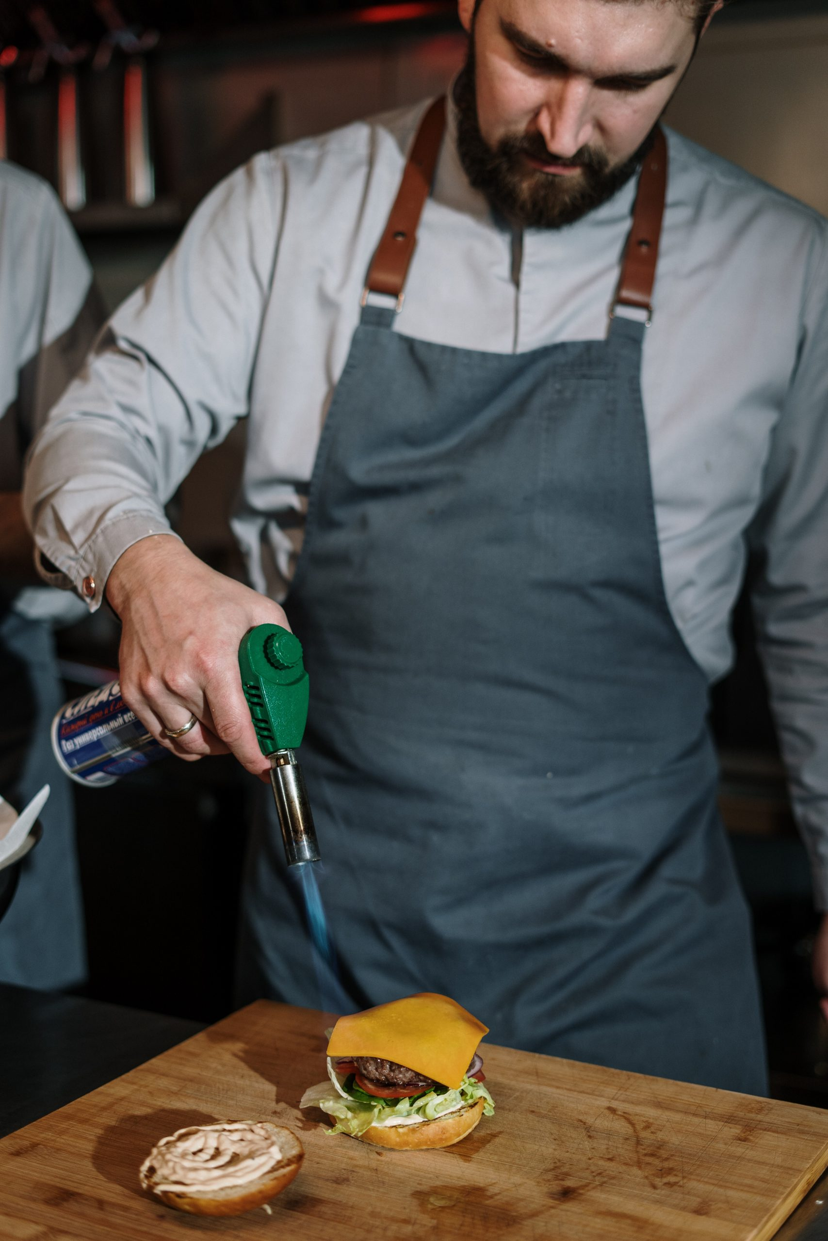 man-in-white-dress-shirt-holding-green-and-silver-hand-tool-4253712